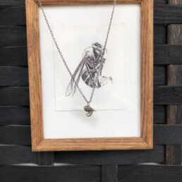 Wasp pendant cast in sterling sliver with framed drawing