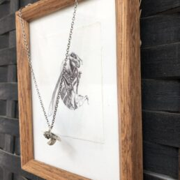 Wasp pendant cast in sterling sliver with framed drawing from side