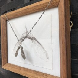 Sycamore pendant cast in sterling sliver with framed drawing from side
