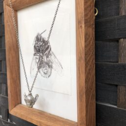 Framed Bumblebee Drawing and Pendant from the side